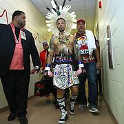 """Orlando """"El Fenomeno""""  Cruz walks down the hall in the arena prior to his match against  Gabino """"Flash"""" Cota during the Boxeo Telemundo WBO/NABO Super Featherweight bout on Friday, October 9, 2015 at the Kissimmee Civic Center in Kissimmee, Florida. Cruz, who is from Puerto Rico, is the first ever openly gay boxer  in the history of the sport and won the bout by unanimous decision.  (Alex Menendez via AP)"""