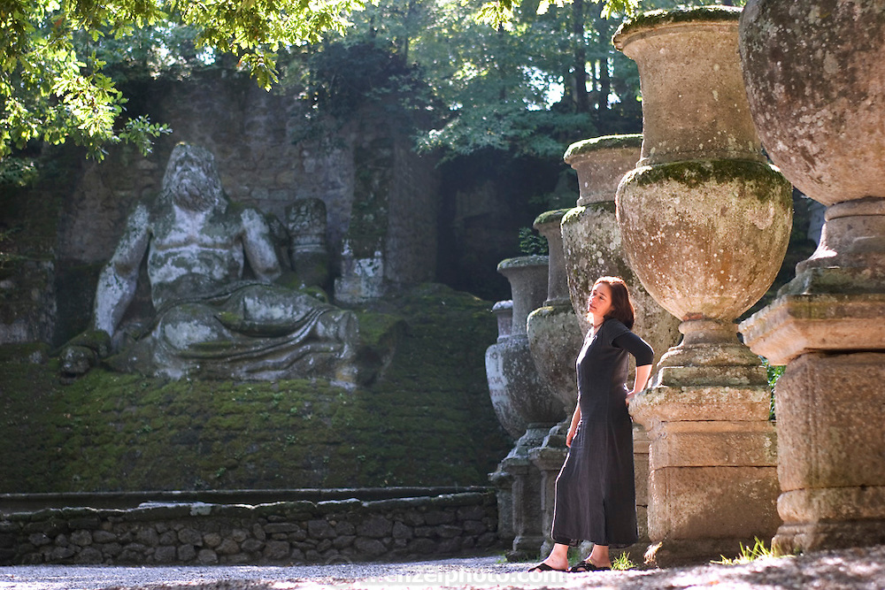 Faith D'Aluisio hangs out at the Park of the Monsters (1552). Devised by the architect Pirro Ligorio on commission of Prince Pier Franceso Orsini, called Vicino, to vent the Prince's broken heart at the death of his wife Giulia Farnese. Bomarzo, Italy. MODEL RELEASED..