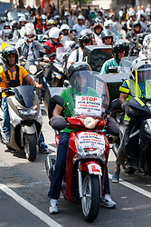 © Licensed to London News Pictures. 18/07/2017. London, UK. Motorbiked couriers, mostly employed by Deliveroo and Uber Eats, stage a protest over acid attacks and motorcycles thefts in Parliament Square, Westminster, London on Tuesday, 18 July 2017. Photo credit: Tolga Akmen/LNP