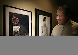 A 1964 picture of Ali defeating Liston (left) and a charcoal portrait of Ali, 18, is prominently displayed in Art Tinajero's Anaheim Hillls home. A father's day gift from his sons and a fortunate set of circumstances ended in the most memorable meeting of his life in 1991.  //ADDITIONAL INFO: Mr. Tinajero has written a fine True Life about a chance lunch with Muhammad Ali.   Tinajero but after a chance meeting with the champ he became a ''life-long fan.'' Ali graciously invited him to lunch after the fan asked for an autograph. true_ali.1231.cy  - 121708 CINDY YAMANAKA, THE ORANGE COUNTY REGISTER - CQ's (Credit Image: © The Orange County Register/ZUMAPRESS.com)