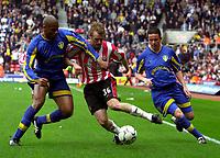 Photo. Richard Lane<br />Southampton v Leeds United. Barclaycard Premiership 19/04/2003.<br />Brett Ormerod gets past Michael Duberry (lt) and Gary Kelly.
