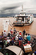 Ferries are an essential form of transportation across the Mekong River. Each carries motorbikes, cars and trucks, as well as food and other products. The ferries are being replaced in some areas by modern suspension brides as Vietnam upgrades its infrastructure. Robert Dodge, a Washington DC photographer and writer, has been working on his Vietnam 40 Years Later project since 2005. The project has taken him throughout Vietnam, including Hanoi, Ho Chi Minh City (Saigon), Nha Trang, Mue Nie, Phan Thiet, the Mekong, Sapa, Ninh Binh and the Perfume Pagoda. His images capture scenes and people from women in conical hats planting rice along the Red River in the north to men and women working in the floating markets one the Mekong River and its tributaries. Robert's project also captures the traditions of ancient Asia in the rural markets, Buddhist Monasteries and the celebrations around Tet, the Lunar New Year. Also to be found are images of the emerging modern Vietnam, such as young people eating and drinking and embracing the fashions and music of the west.