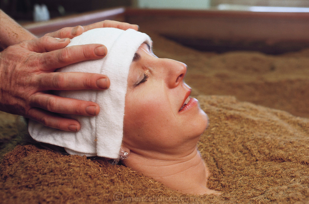 Woman enjoys an enzyme bath at the International Spa in Calistoga, Napa Valley, California.