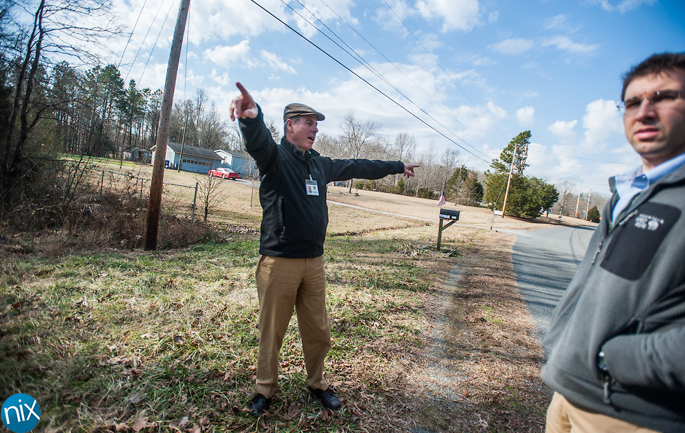 Midland town planner Richard Flowe and town administrator David Pugh point out where a new sewer line is going that will help spur development in the area.