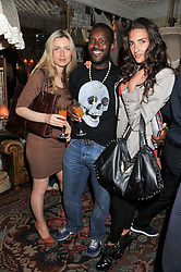 Left to right, ANASTASIA ELISEE, ORLANDO HAMILTON and KAREN EL-KHAZEN shoe designer at an afternoon tea party in aid of the Naked Heart Foundation held at Mari Vanna, Wellington Court, 116 Knightsbridge, London on 29th August 2012.