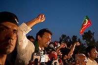 Imran Khan, chairman of the Pakistan Tehreek-e-Insaf political party gestures while speaking to supporters from the stage during an election campaign rally in Faisalabad, Pakistan, Sunday, May 5, 2013. Pakistan is scheduled to hold parliamentary elections on May 11, the first transition between democratically elected governments in a country that has experienced three military coups and constant political instability since its creation in 1947.
