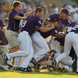 06 June 2009:  LSU players charge the mound and dogpile on top of pitcher Matty Ott following a 5-3 victory by the LSU Tigers over the Rice Owls in game two of the NCAA baseball College World Series, Super Regional played at Alex Box Stadium in Baton Rouge, Louisiana. The Tigers with the win advance to next week's College Baseball World Series in Omaha, Nebraska.
