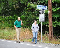 Joe Ksiaskiewicz and his daughter Ann Winner walk back to their car after being denied entry by police into the community where they live. Police surround a neighborhood in the Pocono Mountains in search of ambush suspect Eric Matthew Frein who is accused of shooting two Pennsylvania State Troopers Saturday Sept. 20th, 2014 in Canadensis, Pennsylvania (AP Photo/Chris Post)