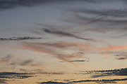 Soft clouds in a dusk sky over south London, on 24th August 2019, in London, England.