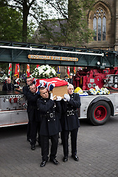 © Licensed to London News Pictures . 02/09/2013 . Bury , UK . Stephen Hunt's coffin is carried off a vintage fire truck and in to the church .  The funeral of fireman Stephen Hunt at Bury Parish Church today (Tuesday 3rd September 2013) . Stephen Hunt died whilst tackling a blaze at Paul's Hair World in Manchester City Centre in July 2013 . Photo credit : Joel Goodman/LNP