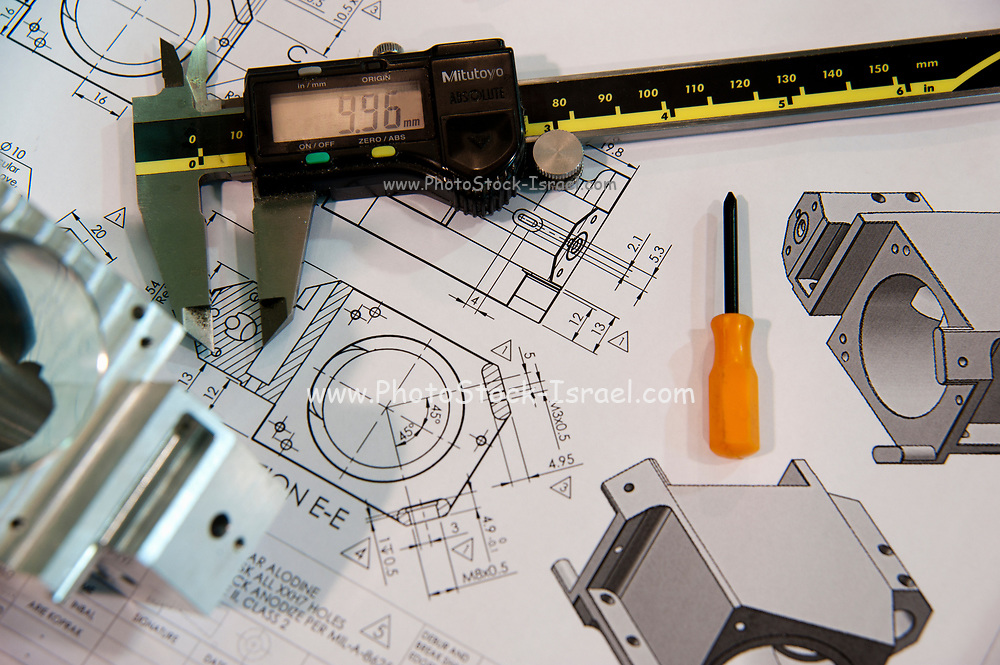 Metal tooling shop floor concept with CAD blueprint and micrometer calliper