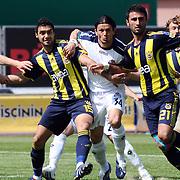 Kasimpasaspor's Cristian KELLER (L), Emre TORAMAN (C) and Fenerbahce's Bekir IRTEGUN  (2ndL), Selcuk SAHIN (R), Diego Alfredo Lugano MORENO (B) during their Turkish superleague soccer match Kasimpasaspor between Fenerbahce at the Recep Tayyip Erdogan stadium in Istanbul Turkey on Sunday 25 April 2010. Photo by TURKPIX