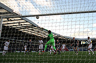 Portugal goalkeeper Beto (22) (Goztepe) tips over the header from Portugal midfielder Sergio Oliveira (15) (Porto) to stop a spectacular own goal during the Friendly international match between Scotland and Portugal at Hampden Park, Glasgow, United Kingdom on 14 October 2018.