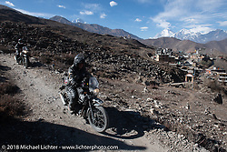 Kelly Modlin riding back to Muktinath from the Buddhist temple above the town on day-6 of our Himalayan Heroes adventure riding from Muktinath to Tatopani, Nepal. Sunday, November 11, 2018. Photography ©2018 Michael Lichter.