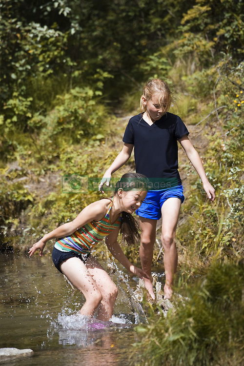 July 21, 2019 - Two Girls Playing In Water (Credit Image: © Carson Ganci/Design Pics via ZUMA Wire)