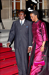 File photo dated February 20, 2003 of Zimbabwean President Robert Mugabe and his wife Grac arriving for an offical dinner at the Elysee Palace during the 22nd Franco-African summi in Paris, France. Zimbabwe's first post-independence leader Robert Mugabe has died aged 95. He was ousted in a military coup in November 2017, ending three decades in power. He won Zimbabwe's first election after independence, becoming prime minister in 1980. He abolished the office in 1987, becoming president instead. Photo by Giancarlo Gorassini/ABACAPRESS.COM