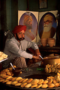 A Sikh man selling bhajis from his street stall