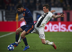 November 27, 2018 - Turin, Italy - Mario Mandzukic (R) of Juventus disputes the ball with Goncalo Guedes of Valencia during the UEFA Champions League match between Juventus and Valencia CF at Allianz Juventus Stadium  in Turin, Italy on November 27, 2018  (Credit Image: © Jose Breton/NurPhoto via ZUMA Press)