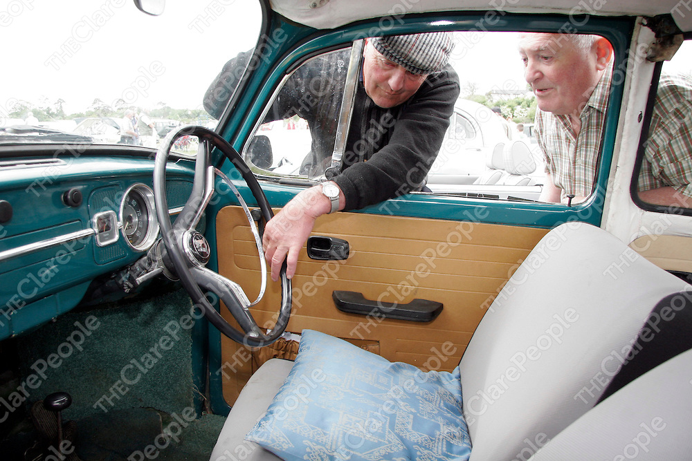 Brendan Price shows Michael Keane his 1966 VW Beetle at the Vintage Car Rally in the Showgrounds on Sunday in aid of Cahercalla Hospice.<br /><br /><br /><br />Photograph by Yvonne Vaughan.