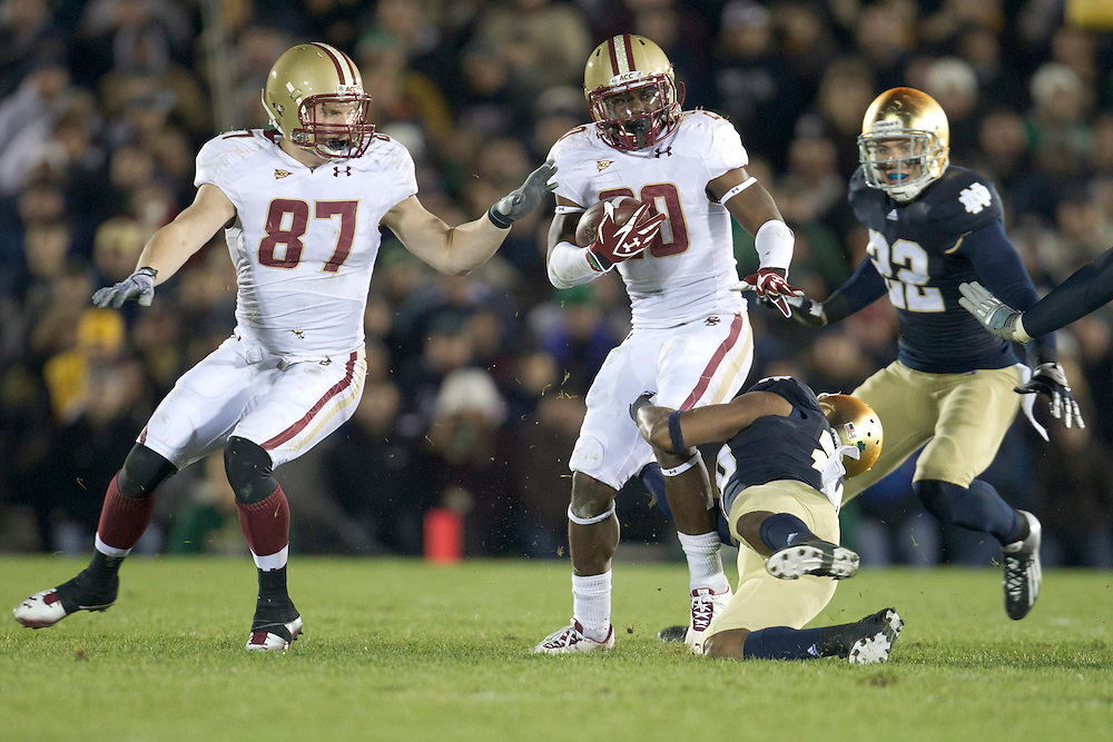 Notre Dame safety Jamoris Slaughter (#26) attempts to make tackle on Boston College running back Tahj Kimble (#20) during third quarter of NCAA football game between Notre Dame and Boston College.  The Notre Dame Fighting Irish defeated the Boston College Eagles 16-14 in game at Notre Dame Stadium in South Bend, Indiana.