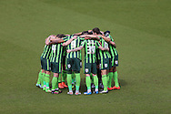 AFC Wimbledon players huddle before k/o. Skybet football league two match, Wycombe Wanderers  v AFC Wimbledon at Adams Park  in High Wycombe, Buckinghamshire on Saturday 2nd April 2016.<br /> pic by John Patrick Fletcher, Andrew Orchard sports photography.