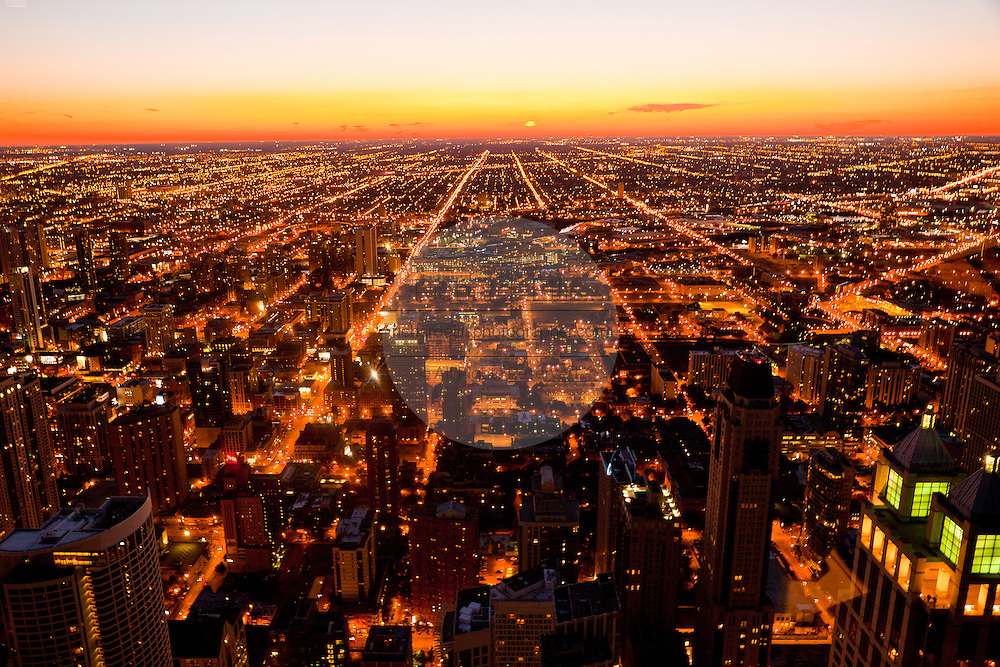 Sunset over the Chicago skyline looking west from the Hancock Tower along the lake front in Chicago, IL, USA.