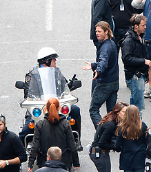 "Brad Pitt speaks to the police motorbike rider on the set of the movie ""World War Z"" being shot in the city centre of Glasgow. The film, which is set in Philadelphia, is being shot in various parts of the Glasgow, transforming it to shoot the post apocalyptic zombie film..© pic : Michael Schofield."