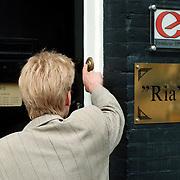 Huize Ria Adam Overtoom 558 Amsterdam, man die aanbelt bij een sexclub