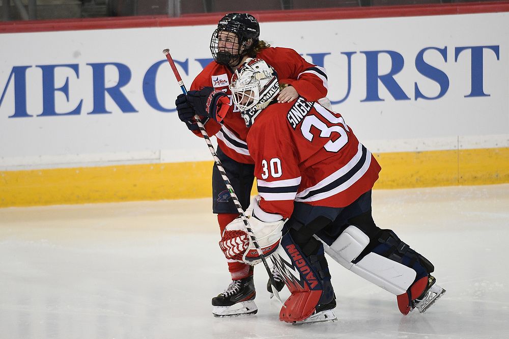 ERIE, PA - MARCH 05: Maggy Burbidge #9 of the Robert Morris Colonials hugs Molly Singewald #30 after scoring the game winning goal in overtime to give the Colonials a 3-2 win over the Mercyhurst Lakers at the Erie Insurance Arena on March 5, 2021 in Erie, Pennsylvania. (Photo by Justin Berl/Robert Morris Athletics)