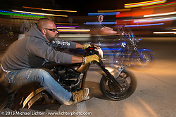 Riding Sturgis' Main Street at night during the 75th Annual Sturgis Black Hills Motorcycle Rally.  SD, USA.  August 3, 2015.  Photography ©2015 Michael Lichter.