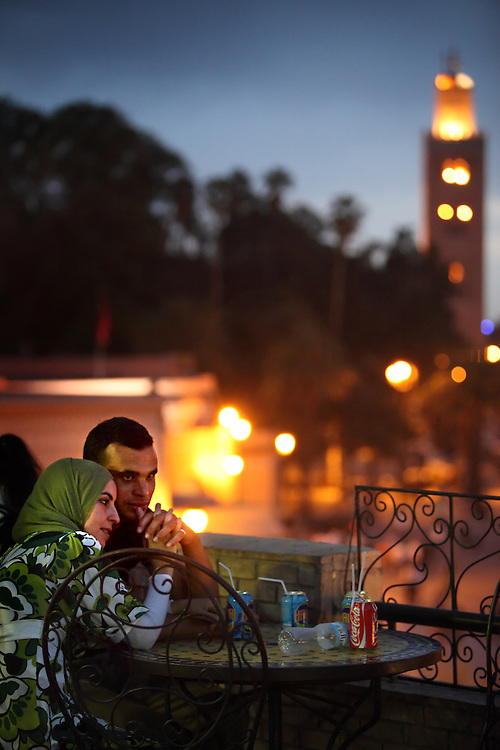 A young couple relaxes on a terrace overlooking Djemaa el Fna square, meaning Place of the Dead, in Marrakech, Morocco on May 9, 2009.