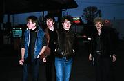 Photo of U2 - The Edge, Larry Mullen, Bono, Adam Clayton at gas station in Atlanta - USA Tour 1981