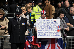 © Licensed to London News Pictures. 10/04/2017. LONDON, UK.  Crowds gather for the procession and funeral cortege of PC Palmer outside Southwark Cathedral in London, where a full police funeral takes place this afternoon. <br /> PC Keith Palmer was stabbed to death whilst on duty in Westminster by terrorist extremist Khalid Masood last month..  Photo credit: Vickie Flores/LNP