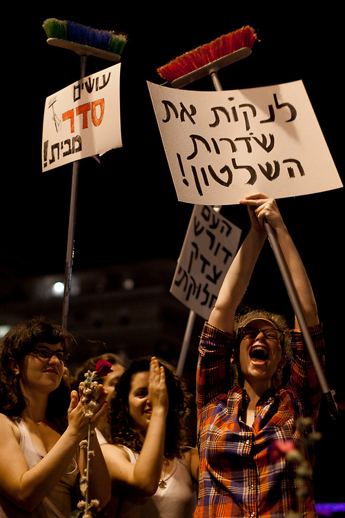 Israeli protesters take part in a demonstration for lower housing and property prices and against social inequalities and the high cost of living in Israel, in Jerusalem on August 6, 2011. Hundreds of thousands of Israelis poured into the streets of major cities for the third Saturday night in a row, in a swelling protest against a wide array of social and economic issues.