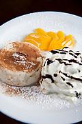Panna cotta with cream and peaches