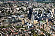 Nederland, Zuid-Holland, Rotterdam, 23-05-2011;.Nieuw- en hoogbouw bij het Centraal Station (l,m) in Rotterdam aan het Weena. De zwarte hoogbouw van de Delftse Poort met het gebouw van Nationale Nederlanden (oranje logo), links voor het station het Groothandelsgebouw. Rechts het groene dak van congres- en concertcentrum De Doelen aan het Kruisplein. Aan de horizon Hillegersberg. .New high-rise buildings near the Central Station (l, m) at the Weena in Rotterdam. The black towers of the Delftse Poort with the Nationale Nederlanden building (orange logo), next (l) to the railwaystation the Groothandelsgebouw. The green roof of conference and concert center De Doelen at Kruisplein (r)..luchtfoto (toeslag), aerial photo (additional fee required).copyright foto/photo Siebe Swart
