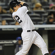 John Ryan Murphy, New York Yankees, batting after breaking his bat during the New York Yankees V Chicago Cubs, double header game two at Yankee Stadium, The Bronx, New York. 16th April 2014. Photo Tim Clayton