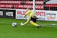 Cameron Dawson of Sheffield Wednesday makes a save in the penalty shoot out during the EFL Cup match between Walsall and Sheffield Wednesday at the Banks's Stadium, Walsall, England on 5 September 2020.