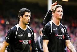 Luis Suarez and Fernando Torres give a lap of honour after the final whistle  - Photo mandatory by-line: Matt McNulty/JMP - Mobile: 07966 386802 - 29/03/2015 - SPORT - Football - Liverpool - Anfield Stadium - Gerrard's Squad v Carragher's Squad - Liverpool FC All stars Game