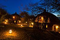 Boma (guest cottages) at twilight, Serengeti Serena Lodge, Serengeti National Park, Tanzania