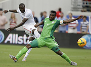 JACKSONVILLE, FL - JUNE 07:  Forward Jozy Altidore #17 of the United States shoots and scores his second game of the game behind defender Joseph Yobo #2 of Nigeria during the international friendly match at EverBank Field on June 7, 2014 in Jacksonville, Florida.  (Photo by Mike Zarrilli/Getty Images)