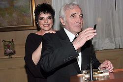US actress and singer Liza Minnelli is greeted by French singer Charles Aznavour after receiving a palm of honor from Festival director Gilles Jacob during a diner held at Carlton Hotel in Cannes during the 58th International Cannes Film Festival, France on May 18, 2005. Photo by Benoit Pinguet/ABACA.