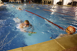 © Licensed to London News Pictures. 29/03/2021. London, UK. Swimmers excercise at Hampton Pool in south west London at 5am. The pool opened for the return to outdoor swimming at 4:44am. Covid regulations have changed today to allow gatherings up to six people outdoors. With sporting facilities, such as tennis,basketball courts and outdoor swimming pools allowed to reopen. Photo credit: Peter Macdiarmid/LNP
