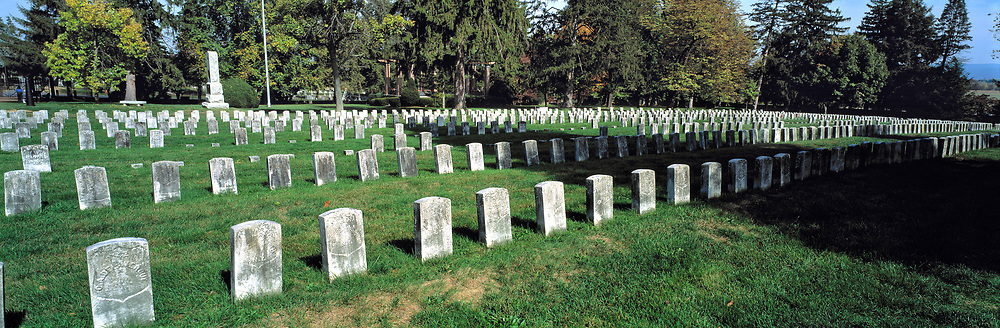 Weathered headstones stand in neat rows on the greens of Antietam National Battlefield Cemetery, in Maryland.