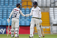 Jonathan Tattersall of Yorkshire and David Willey of Yorkshire punch gloves during the opening day of the Specsavers County Champ Div 1 match between Yorkshire County Cricket Club and Hampshire County Cricket Club at Headingley Stadium, Headingley, United Kingdom on 27 May 2019.