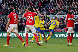 Middlesbrough's Aden Flint and George Friend react after Leeds United's Kalvin Phillips (second right) scores his side's first goal of the game during the Sky Bet Championship match at The Riverside Stadium, Middlesbrough.