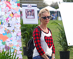 Mary Frances Heller looks at art pieces to celebrate the 17 people killed in a mass shooting at Marjory Stoneman Douglas High School last year in Parkland, FL, USA, Thursday, February, 14, 2019. Photo by Charles Trainor Jr./Miami Herald/TNS/ABACAPRESS.COM