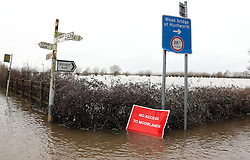 © Licensed to London News Pictures. Burrowbridge. Somerset. 06/02/14. Devon and Somerset Fire and Rescue evacuating local residents from floodwater. Photo credit : Jason Bryant/LNP