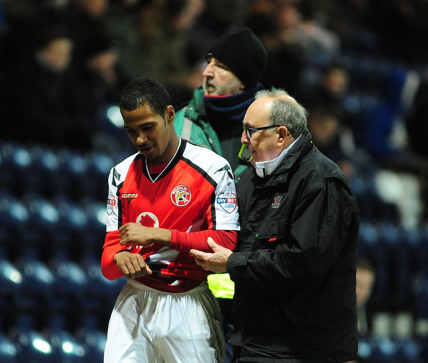 Walsall's Rico Henry is forced off with an injury sustained in the run up to Preston North End's Daniel Johnson scoring the opening goal <br /> <br /> Photographer Chris Vaughan/CameraSport<br /> <br /> Football - The Football League Sky Bet League One - Preston North End v Walsall - Tuesday 24th February 2015 - Deepdale - Preston<br /> <br /> © CameraSport - 43 Linden Ave. Countesthorpe. Leicester. England. LE8 5PG - Tel: +44 (0) 116 277 4147 - admin@camerasport.com - www.camerasport.com