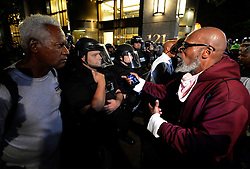 A protester, right, expresses his opinion to a police officer and another pedestrian near Trade and Tryon Streets in Charlotte, NC, USA, on Thursday, September 22, 2016, as demonstrations continue following the shooting death of Keith Scott by police earlier in the week. Photo by Jeff Siner/Charlotte Observer/TNS/ABACAPRESS.COM
